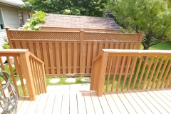 Power-wash-and-reetain-fence-after-